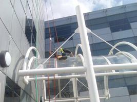 Abseiler cleaning glass entrance canopy